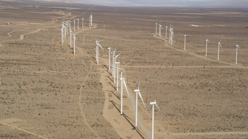 5K stock footage aerial video orbit long row of windmills at a wind farm in the desert of Antelope Valley, California Aerial Stock Footage | AX0006_049