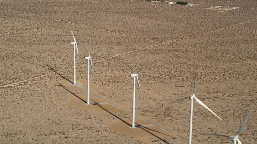 5K stock footage aerial video approach four windmills at a desert wind farm in Antelope Valley, California Aerial Stock Footage | AX0006_051