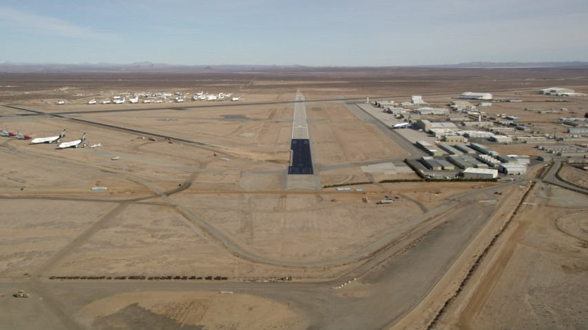 5K stock footage aerial video approach runway at Mojave Air and Space Port in California Aerial Stock Footage | AX0006_054