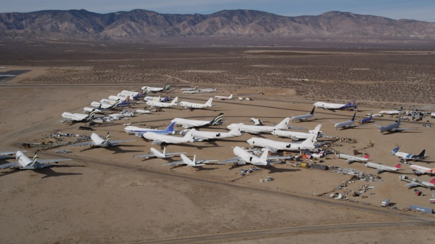 5K aerial video orbit group of airplanes at an aircraft boneyard in the California desert, Mojave Air and Space Port Aerial Stock Footage | AX0006_059