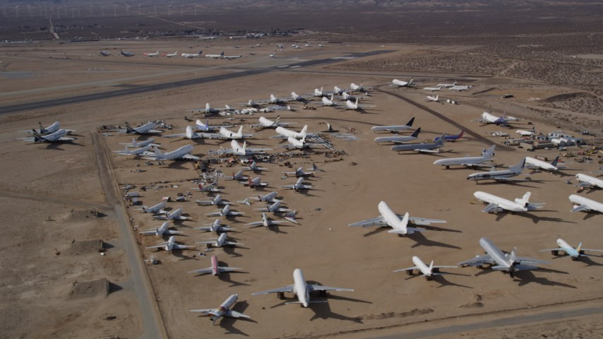5K aerial video orbit around an aircraft boneyard in the desert, Mojave Air and Space Port, California Aerial Stock Footage | AX0006_060