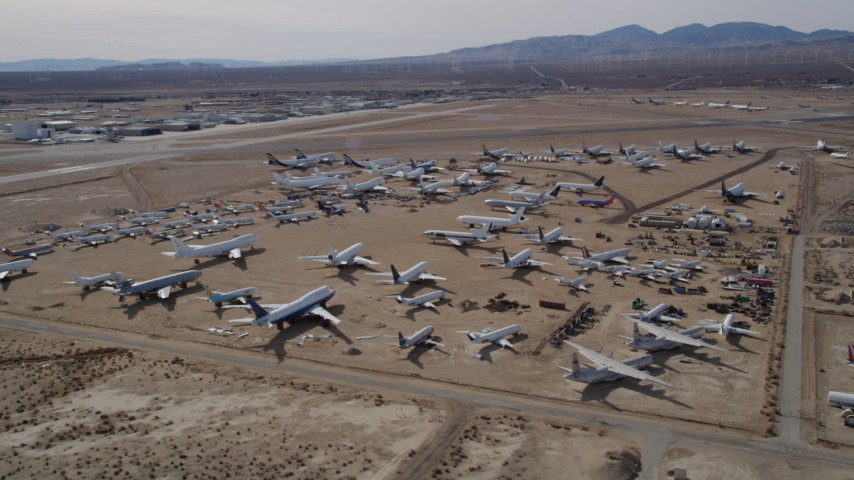5K stock footage aerial video orbiting an aircraft boneyard in the Mojave Desert, California Aerial Stock Footage | AX0006_061