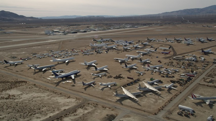 5K stock footage aerial video orbiting an aircraft boneyard in the Mojave Desert, California Aerial Stock Footage | AX0006_061E