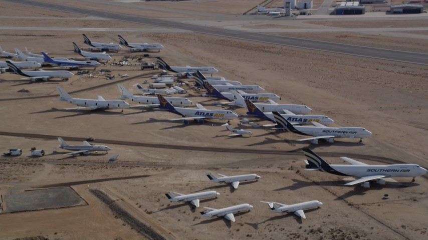 5K stock footage aerial video orbit a group of aircraft at a boneyard in the Mojave Desert, California Aerial Stock Footage | AX0006_064