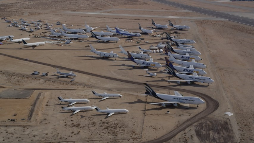 5K stock footage aerial video orbit large group of aircraft at a desert boneyard in California's Mojave Desert Aerial Stock Footage | AX0006_065