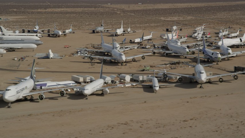 5K stock footage aerial video of rows of airplanes at an aircraft boneyard in the Mojave Desert, California Aerial Stock Footage | AX0006_066E