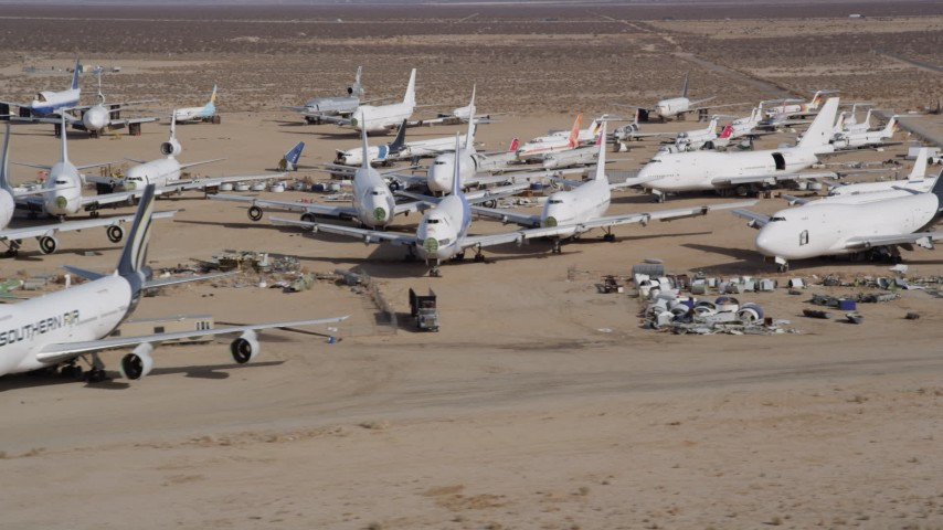 5K stock footage aerial video orbit cargo and passenger jets at a boneyard in the Mojave Desert, California Aerial Stock Footage | AX0006_067
