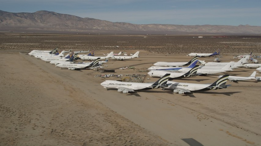 5K stock footage aerial video of jet aircraft at a desert boneyard in California's Mojave Desert Aerial Stock Footage | AX0006_068