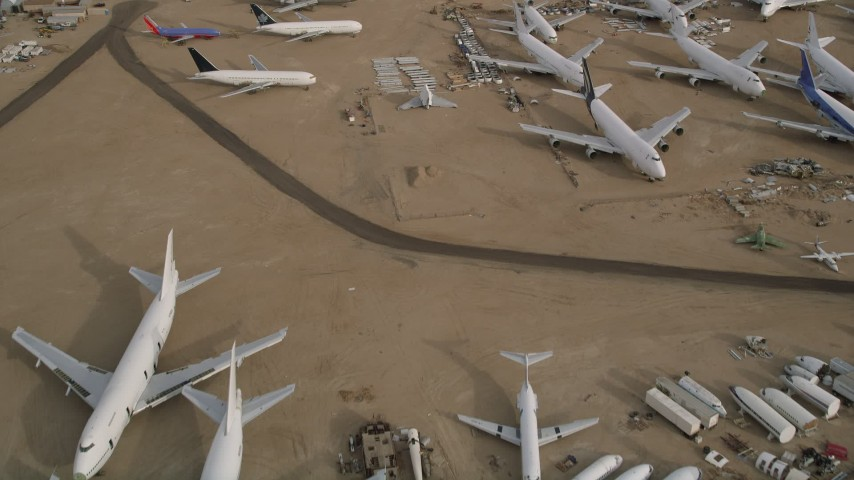 5K stock footage aerial video fly over several jet airplanes at an aircraft boneyard in the Mojave Desert, California Aerial Stock Footage | AX0006_079E