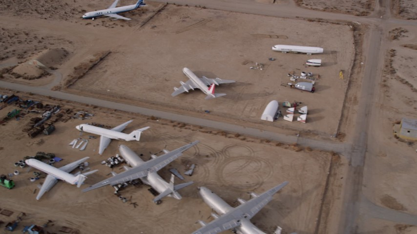 5K stock footage aerial video circle over planes at an aircraft boneyard in the Mojave Desert, California Aerial Stock Footage | AX0006_082