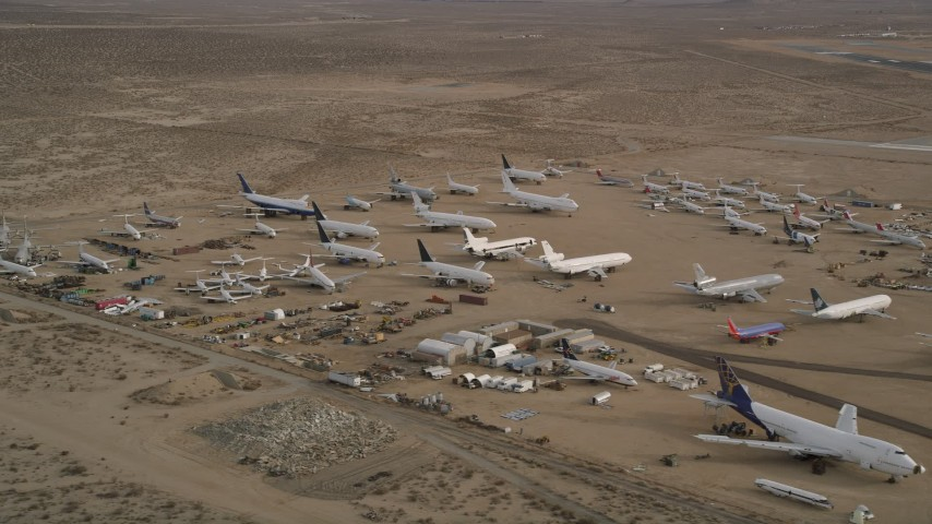 5K stock footage aerial video of airplanes and components at an aircraft boneyard, Mojave Air and Space Port, California Aerial Stock Footage | AX0006_086