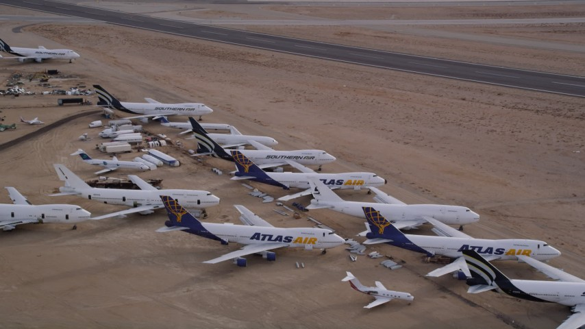 5K stock footage aerial video approach group of jet airplanes at a boneyard in the desert, Mojave Air and Space Port, California Aerial Stock Footage | AX0006_087