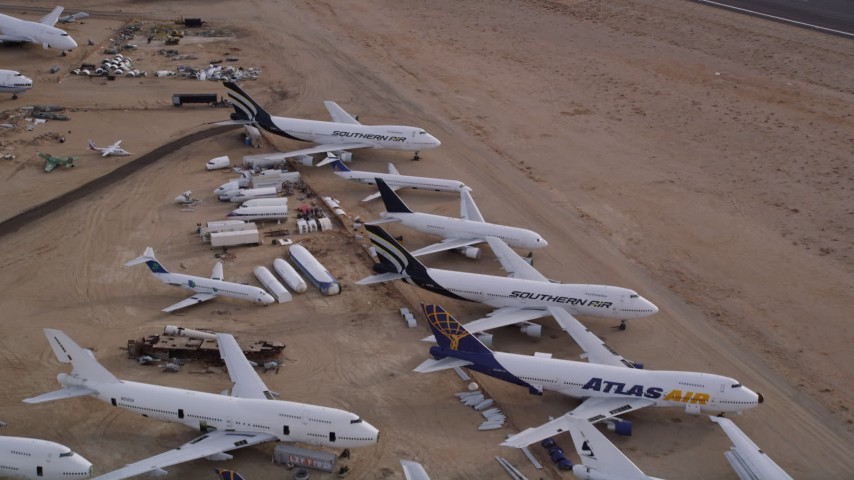 5K stock footage aerial video fly over large jet airplanes at a boneyard in the Mojave Desert, California Aerial Stock Footage | AX0006_088