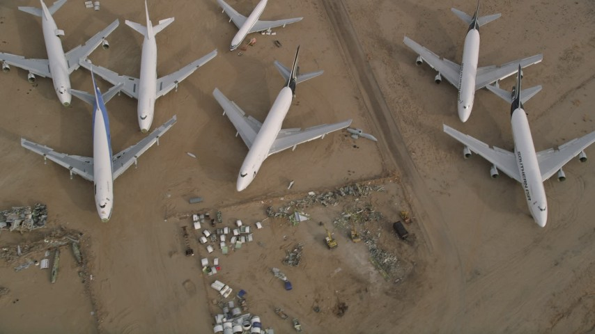 5K stock footage aerial video bird's eye view of a group of airplanes at a boneyard in the desert, Mojave Air and Space Port, California Aerial Stock Footage | AX0006_090