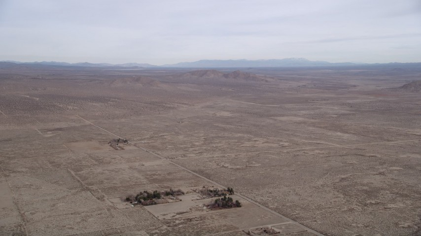 5K stock footage aerial video of panning across the open desert at the Mojave Desert, California Aerial Stock Footage | AX0006_112