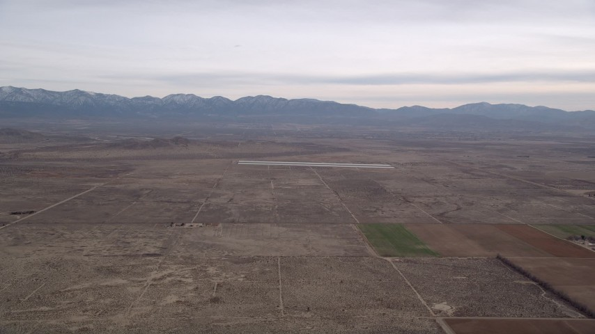 5K stock footage aerial video of VFX Background Plate of open desert and distant mountains, Mojave Desert, California Aerial Stock Footage | AX0006_114