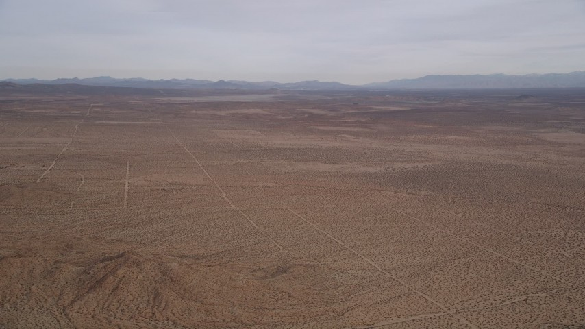 5K stock footage aerial video pan across open desert and mountains in the Mojave Desert, California Aerial Stock Footage | AX0006_118