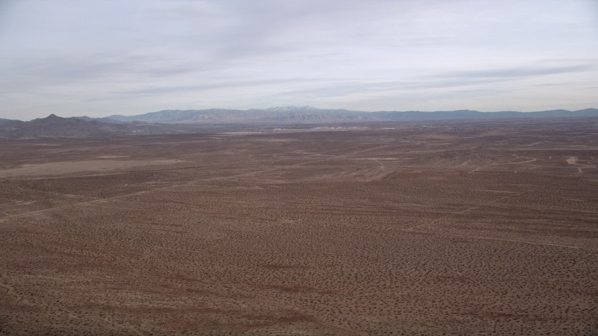 5K stock footage aerial video of a Mojave Desert Background VFX Plate, California Aerial Stock Footage | AX0006_151