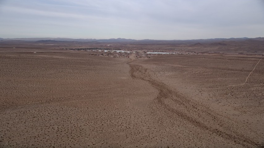 5K aerial stock footage video of approaching a small desert town, Helendale, California Aerial Stock Footage | AX0006_157E