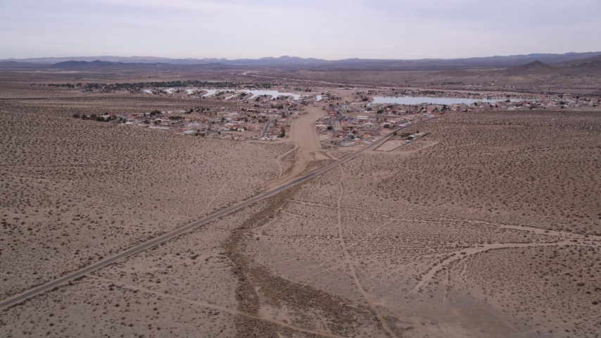 5K stock footage aerial video approach homes on the outskirts of the small desert town of Helendale, California Aerial Stock Footage | AX0006_162