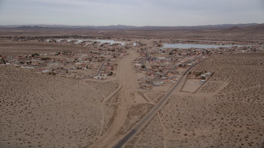 5K stock footage aerial video approach homes on the outskirts of the small desert town of Helendale, California Aerial Stock Footage | AX0006_162E