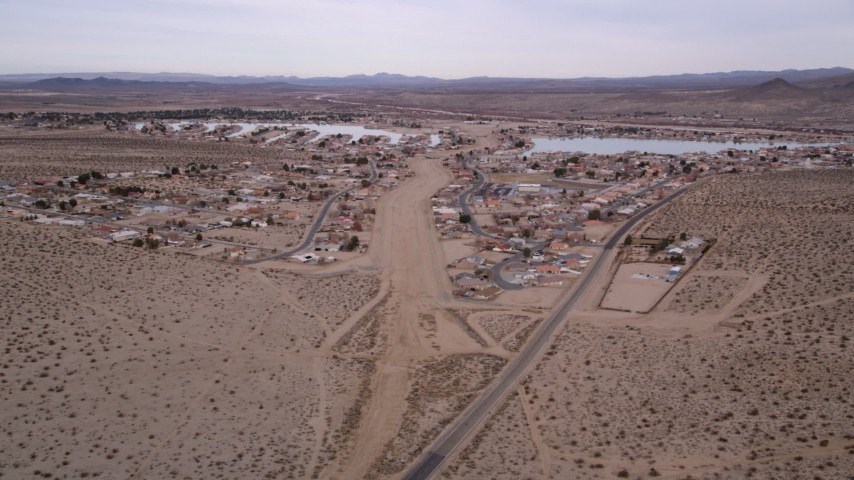 5K stock footage aerial video approach small desert town and homes in Helendale, California Aerial Stock Footage | AX0006_163