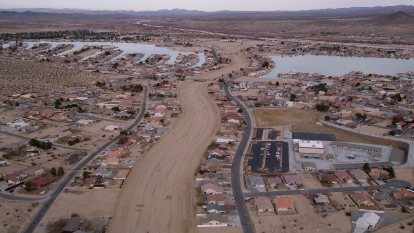 5K stock footage aerial video fly over small desert town with two lakes in Helendale, California Aerial Stock Footage | AX0006_164