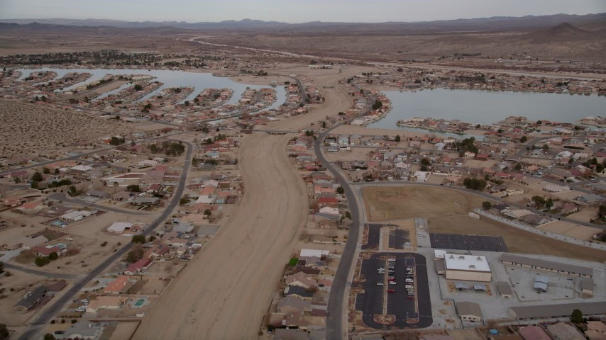 5K stock footage aerial video fly over small desert town with two lakes in Helendale, California Aerial Stock Footage | AX0006_164E