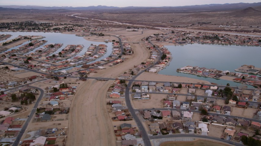 5K stock footage aerial video approach lakefront homes in the small desert town of Helendale, California Aerial Stock Footage | AX0006_165