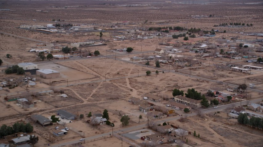 5K stock footage aerial video fly over rural homes in the small desert town of Victorville, California at Sunset Aerial Stock Footage AX0007_014 | Axiom Images