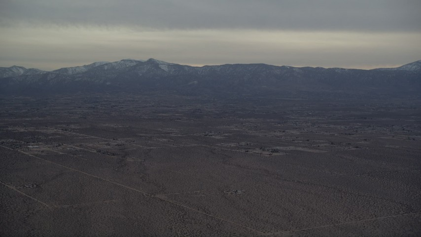 5K stock footage aerial video of Background VFX Plate of Mojave Desert and mountains with snow at Sunset, California Aerial Stock Footage | AX0007_020