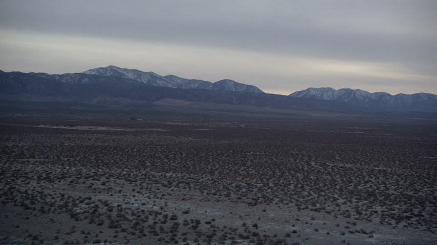 5K stock footage aerial video of VFX Plate of Mojave Desert and mountains with snow at twilight, California Aerial Stock Footage | AX0007_030