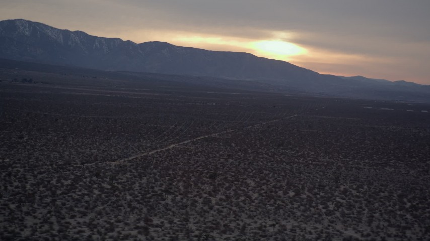 5K stock footage aerial video orbit power lines and desert road at twilight in the Mojave Desert, California Aerial Stock Footage | AX0007_032