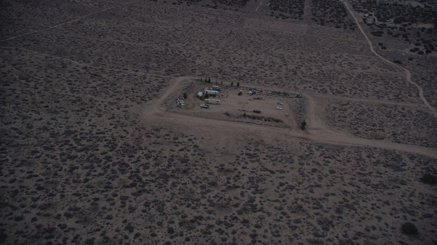 5K stock footage aerial video orbit a small group of RVS in the Mojave Desert at twilight, California Aerial Stock Footage   AX0007_040