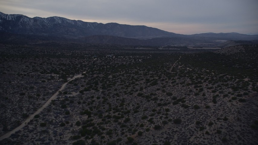 5K stock footage aerial video approach isolated home while flying over the Mojave Desert at twilight, California Aerial Stock Footage | AX0007_044