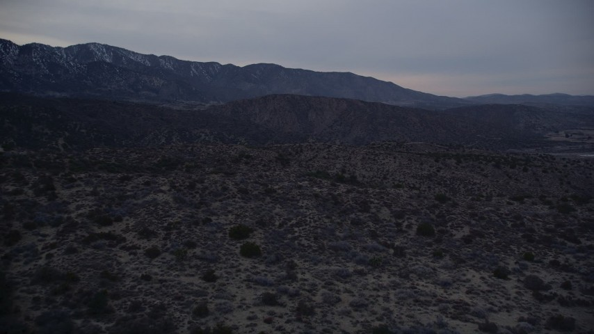 5K aerial video fly over the Mojave Desert near distant mountains at twilight in California  Aerial Stock Footage | AX0007_047