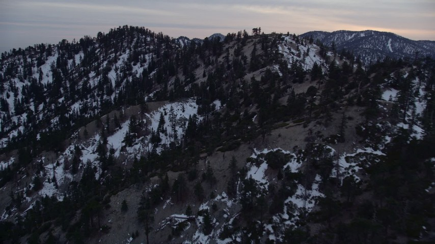 5K stock footage aerial video of snowy mountain ridge at twilight in the San Gabriel Mountains in winter, California Aerial Stock Footage | AX0008_014
