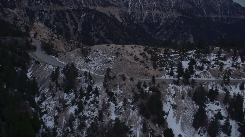 5K stock footage aerial video of a mountain road with winter snow in the San Gabriel Mountains at twilight, California Aerial Stock Footage | AX0008_016