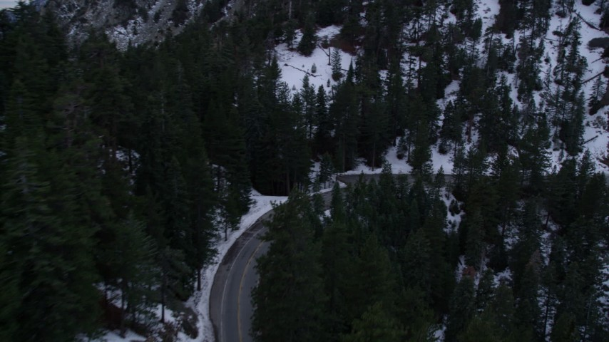 5K stock footage aerial video of a road with winter snow in the San Gabriel Mountains at twilight, California Aerial Stock Footage | AX0008_021