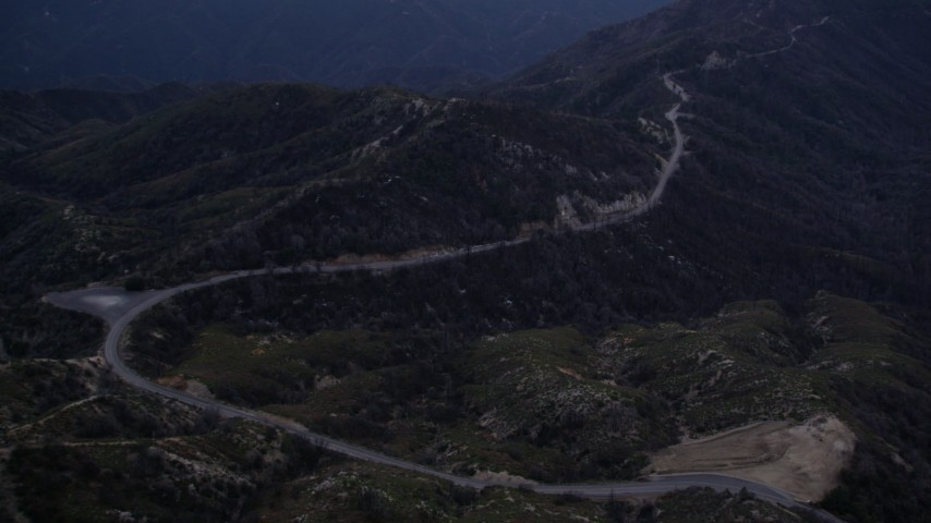 5K stock footage aerial video approach a mountain road at twilight in the San Gabriel Mountains, California Aerial Stock Footage | AX0008_039