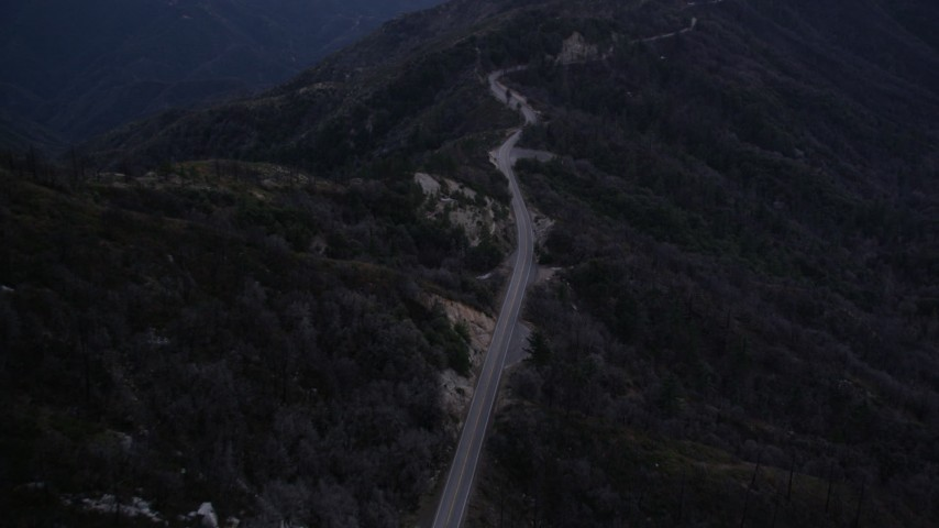 5K stock footage aerial video of following a mountain road up a slope at twilight in the San Gabriel Mountains, California Aerial Stock Footage | AX0008_040
