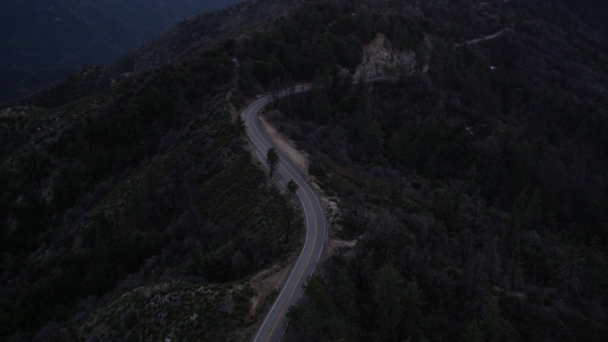 5K stock footage aerial video follow winding mountain road in the San Gabriel Mountains at twilight, California Aerial Stock Footage | AX0008_041