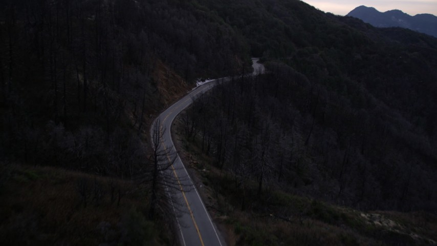 5K aerial video fly over deserted road at twilight in the San Gabriel Mountains, California Aerial Stock Footage | AX0008_042
