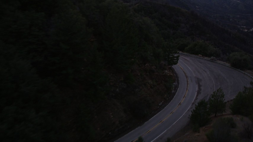 5K aerial video follow lonely road at twilight through the San Gabriel Mountains, California Aerial Stock Footage | AX0008_043
