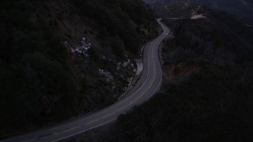 5K stock footage aerial video fly over road at twilight in the San Gabriel Mountains of California Aerial Stock Footage | AX0008_044