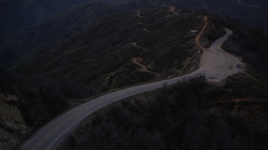 5K stock footage aerial video fly over road and power lines at twilight in the San Gabriel Mountains, California Aerial Stock Footage | AX0008_045