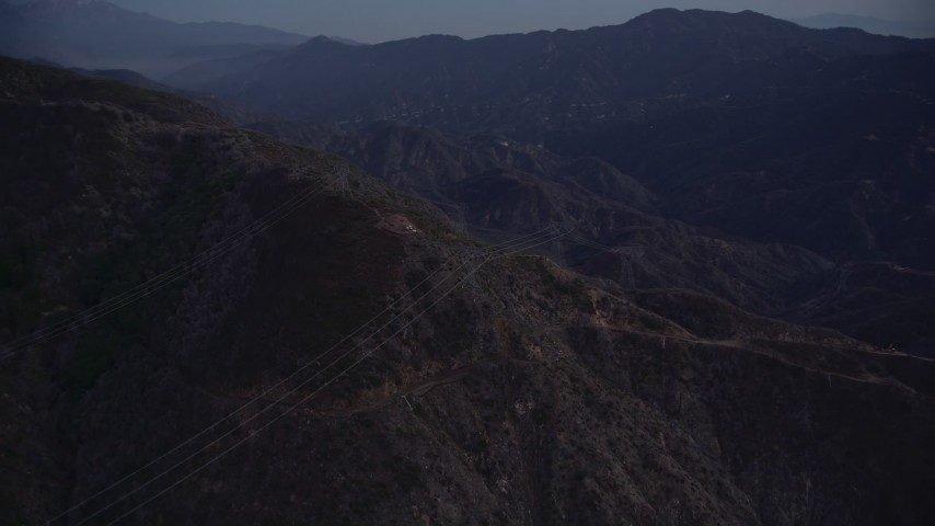 5K stock footage aerial video orbit power lines on a slope at twilight in the San Gabriel Mountains, California Aerial Stock Footage | AX0008_046