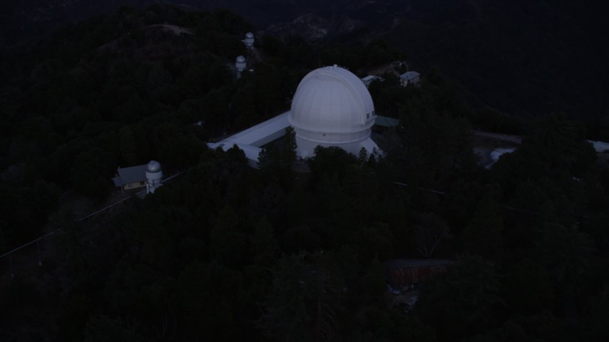 5K stock footage aerial video orbiting around the Mount Wilson Observatory at twilight in California Aerial Stock Footage | AX0008_052