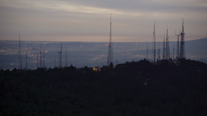 5K aerial video of radio towers atop San Gabriel Mountains at twilight, California Aerial Stock Footage | AX0008_054