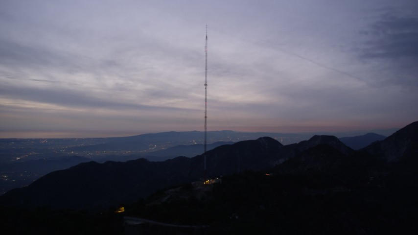 5K aerial video orbit a radio tower in the San Gabriel Mountains at twilight, California Aerial Stock Footage | AX0008_056